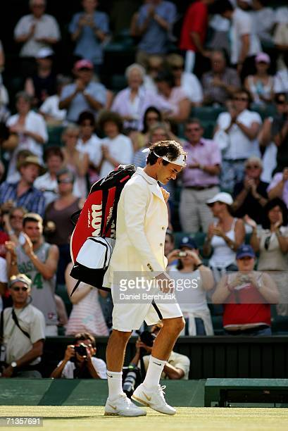 Roger Federer of Switzerland walks out onto centre court to face Tomas Berdych of Czech Republic during day seven of the Wimbledon Lawn Tennis...