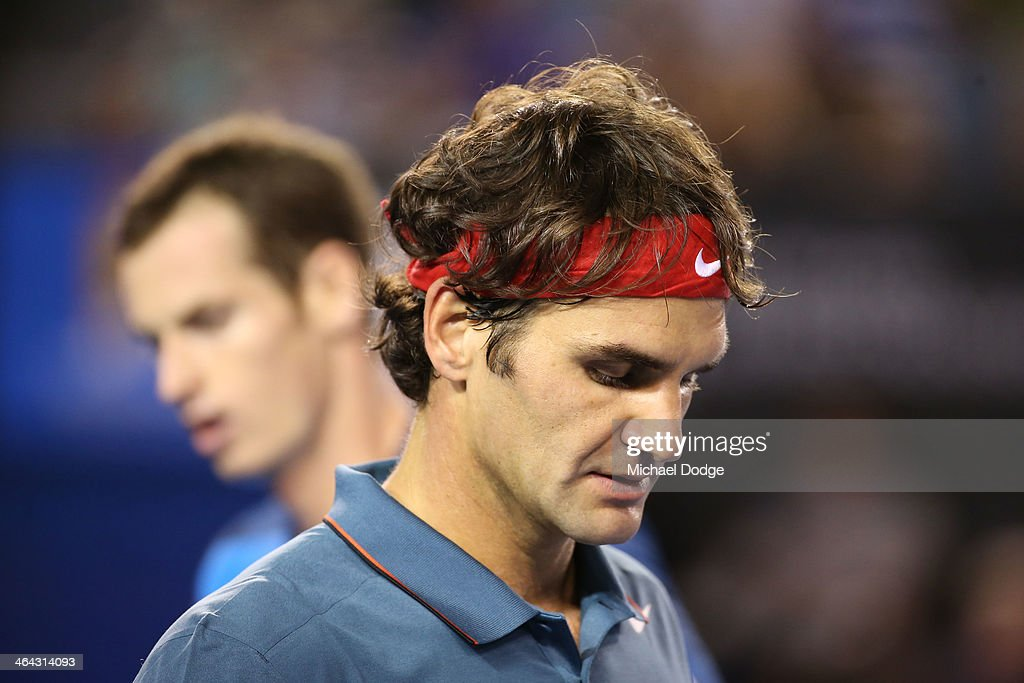 <a gi-track='captionPersonalityLinkClicked' href=/galleries/search?phrase=Roger+Federer&family=editorial&specificpeople=157480 ng-click='$event.stopPropagation()'>Roger Federer</a> of Switzerland walks past Andy Murray of Great Britain in their quarterfinal match during day 10 of the 2014 Australian Open at Melbourne Park on January 22, 2014 in Melbourne, Australia.
