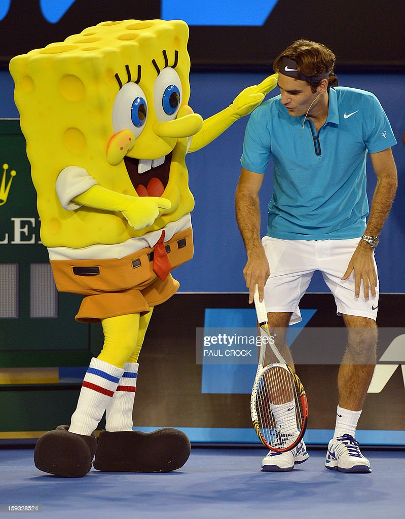 Roger Federer of Switzerland (R) warms up with cartoon character Sponge Bob during a Kids Day exhibition match in the lead-up to the Australian Open tennis tournament in Melbourne on January 12, 2013. The first Grand Slam tennis tournament of the year is set to run from January 14 to 27. AFP PHOTO / Paul CROCK USE