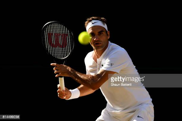 Roger Federer of Switzerland watches the ball during the Gentlemen's Singles semi final match against Tomas Berdych of The Czech Republic on day...