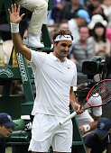 Roger Federer of Switzerland waves his hand after the mens' singles on day one of the 2016 Wimbledon Championships against Guido Pella of Argentina...
