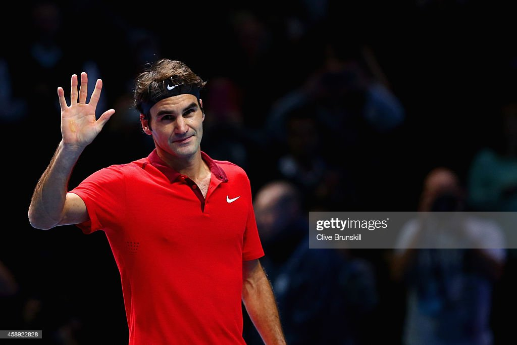 <a gi-track='captionPersonalityLinkClicked' href=/galleries/search?phrase=Roger+Federer&family=editorial&specificpeople=157480 ng-click='$event.stopPropagation()'>Roger Federer</a> of Switzerland waves to the crowd after winning 6-0 6-1 in the round robin singles match against Andy Murray of Great Britain on day five of the Barclays ATP World Tour Finals at O2 Arena on November 13, 2014 in London, England.