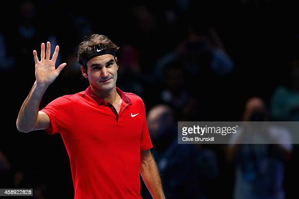 Roger Federer of Switzerland waves to the crowd after winning 60 61 in the round robin singles match against Andy Murray of Great Britain on day five...