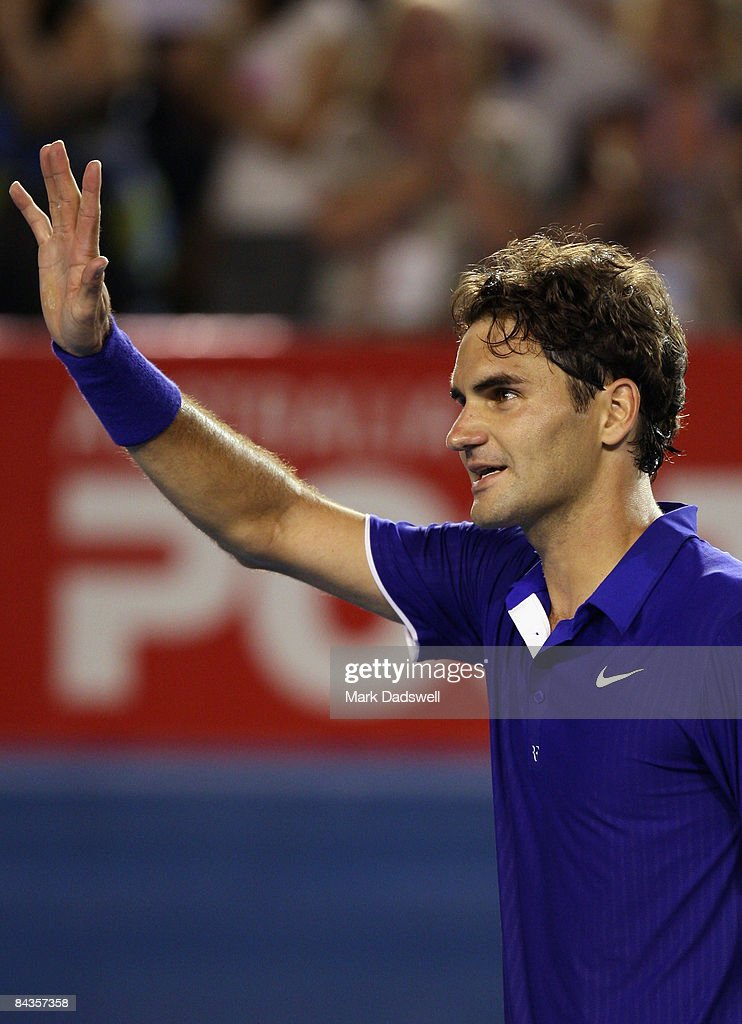 Roger Federer of Switzerland waves to the crowd after winning his first round match against Andreas Seppi of Italy during day one of the 2009 Australian Open at Melbourne Park on January 19, 2009 in Melbourne, Australia.