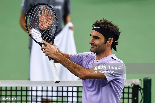 Roger Federer of Switzerland waves to the crowd after winning the match during the men's singles against Alexandr Dolgopolov of Ukraine at the...