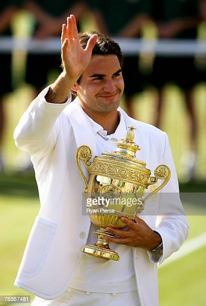 Roger Federer of Switzerland waves to the crowd as he celebrates victory following the Men's Singles final match against Rafael Nadal of Spain during...