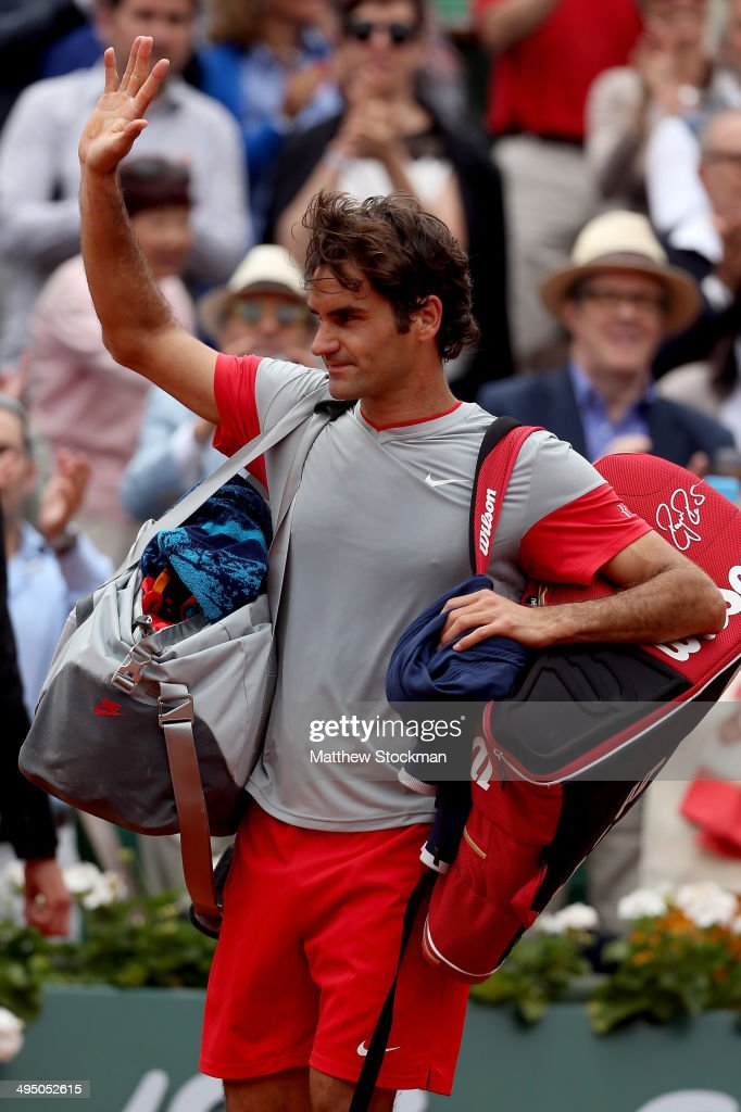 <a gi-track='captionPersonalityLinkClicked' href=/galleries/search?phrase=Roger+Federer&family=editorial&specificpeople=157480 ng-click='$event.stopPropagation()'>Roger Federer</a> of Switzerland waves to the crowd as he leaves the court following his defeat in his men's singles match against <a gi-track='captionPersonalityLinkClicked' href=/galleries/search?phrase=Roger+Federer&family=editorial&specificpeople=157480 ng-click='$event.stopPropagation()'>Roger Federer</a> of Switzerland on day eight of the French Open at Roland Garros on June 1, 2014 in Paris, France.