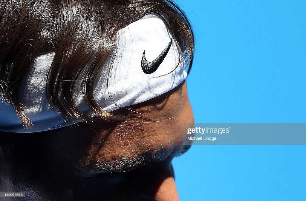 Roger Federer of Switzerland wears his Nike headband during practice ahead of the 2013 Australian Open at Melbourne Park on January 8, 2013 in Melbourne, Australia.