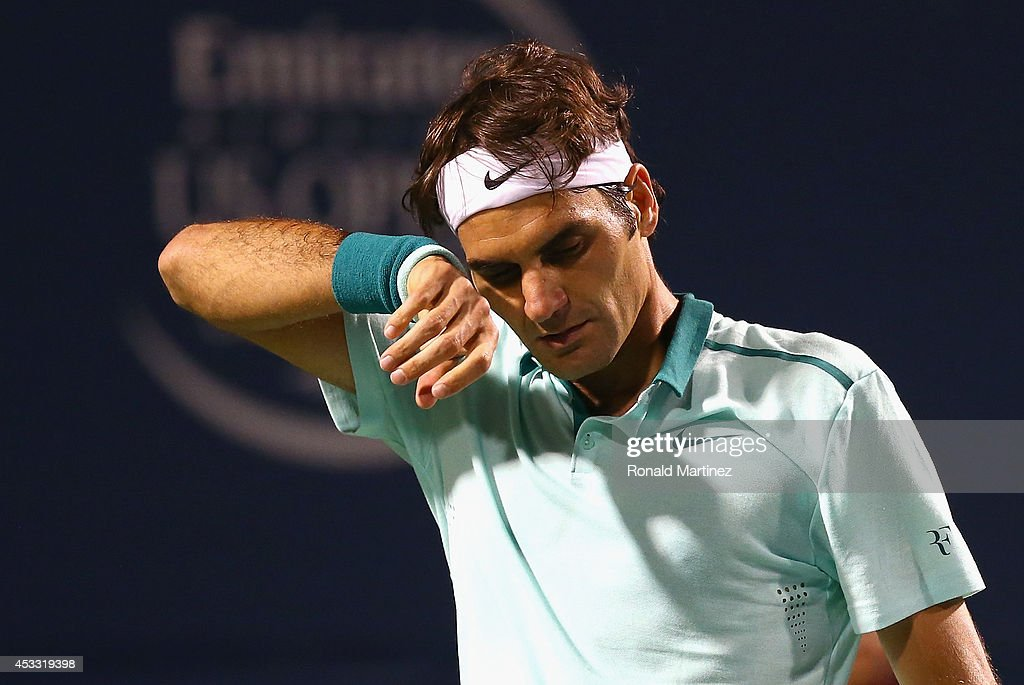 Roger Federer of Switzerland wipes his face during play against Marin Cilic of Croatia during Rogers Cup at Rexall Centre at York University on August 7, 2014 in Toronto, Canada.