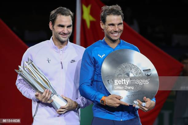 Roger Federer of Switzerland with Rafael Nadal of Spain pose with their trophy after the Men's singles final mach on day eight of 2017 ATP Shanghai...