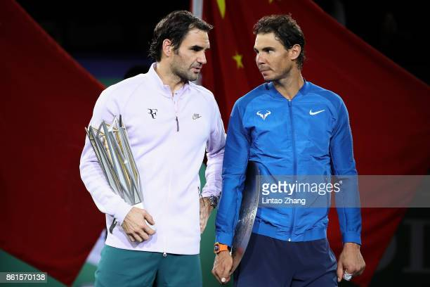Roger Federer of Switzerland with Rafael Nadal of Spain pose with their trophies after the Men's singles final mach on day eight of 2017 ATP Shanghai...
