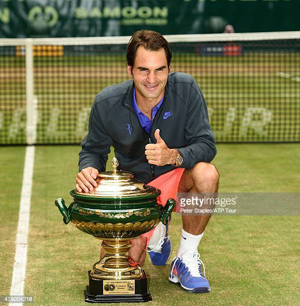 Roger Federer of Switzerland with the Championship Trophy after defeating Andreas Seppi of Italy at the Gerry Weber Open on June 21 2015 in Halle...