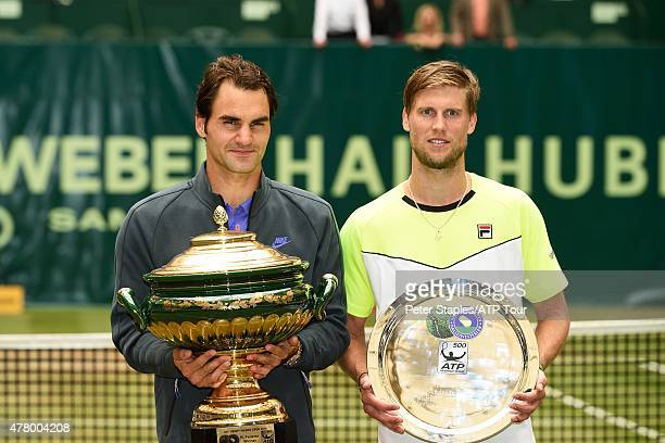 Roger Federer of Switzerland with the Championship Trophy and Andreas Seppi of Italy with the RunnersUp Plate at the Gerry Weber Open on June 21 2015...