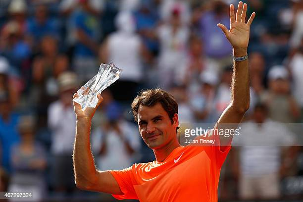 Roger Federer of Switzerland with the runners up trophy after his loss against Novak Djokovic of Serbia in the final during day fourteen of the BNP...