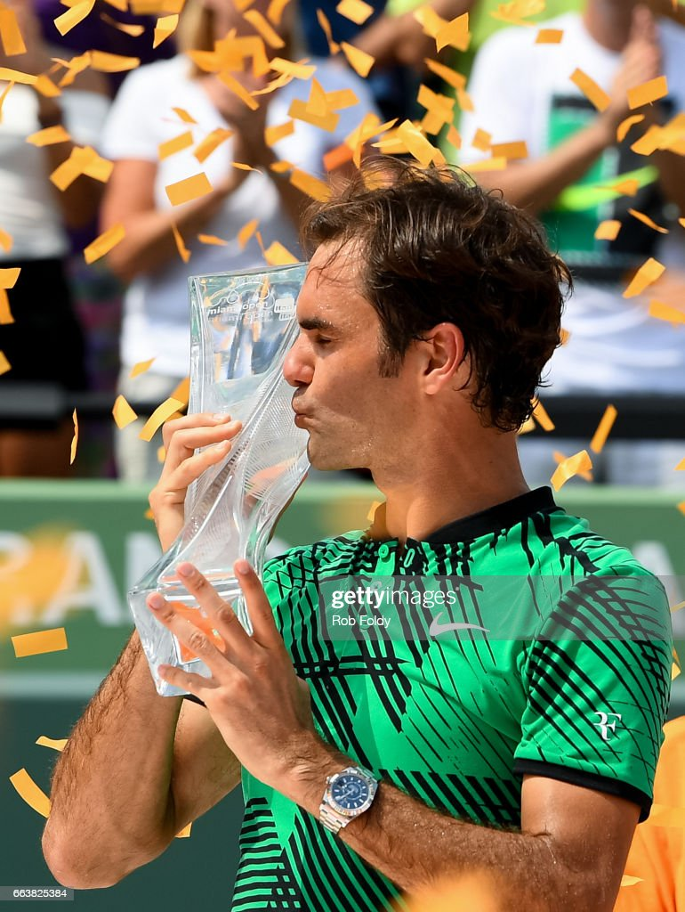 Roger Federer of Switzerland with the winners trophy after defeating Rafael Nadal of Spain on day 14 of the Miami Open at Crandon Park Tennis Center on April 2, 2017 in Key Biscayne, Florida.