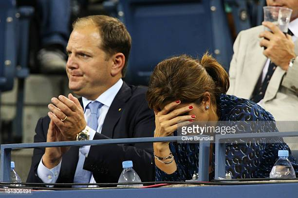 Roger Federer of Switzerland's wife Mirka Federer and agent Tony Godsick watch his men's singles quarterfinal match against Tomas Berdych of Czech...