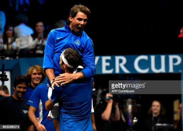 Roger Federer of Team Europe celebrates with his team mate Rafael Nada defeating Nick Kyrgios of during the the Laver Cup on September 24 2017 in O2...
