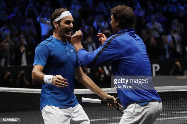 Roger Federer of Team Europe celebrates with Rafael Nadal of Team Europe after winning the Laver Cup on match point during his mens singles match...