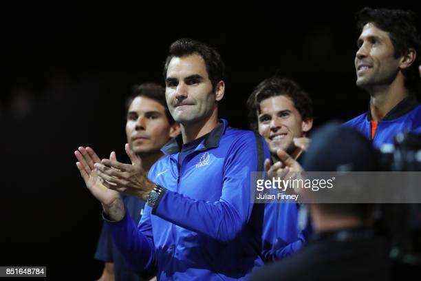 Roger Federer of Team Europe looks on as Denis Shapovalov of Team World plays his singles match against Alexander Zverev of Team Europe serevs on the...