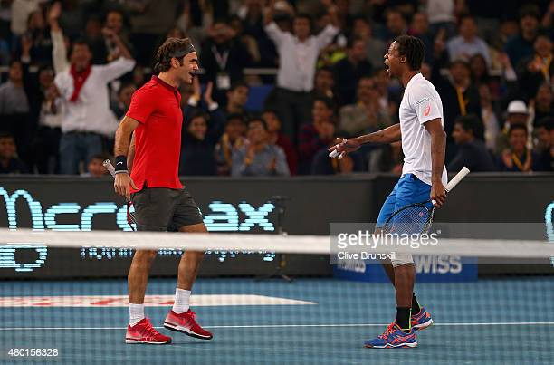 Roger Federer of the Indian Aces celebrates match point with his doubles partner and team mate Gael Monfils after their victory against Novak...