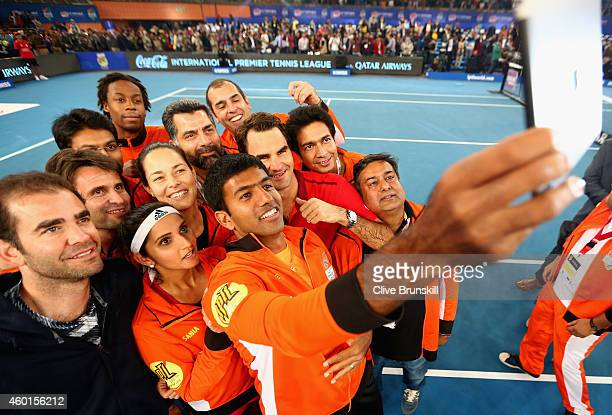 Roger Federer of the Indian Aces does an Indian is photographed on a team selfie by team mate Rohan Bopanna after their match against the UAE Royals...
