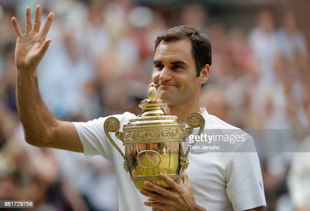 Roger Federer parades the trophy after winning the men's singles final against Marin Cilic on Centre Court on day thirteen of the 2017 Wimbledon...
