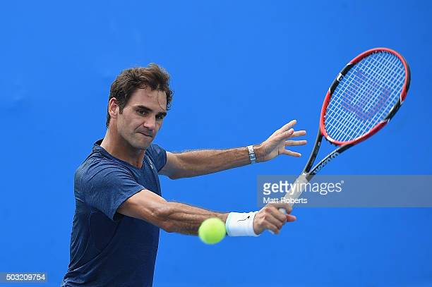 Roger Federer plays a backhand shot during a practice match on day one of the 2016 Brisbane International at Pat Rafter Arena on January 3 2016 in...