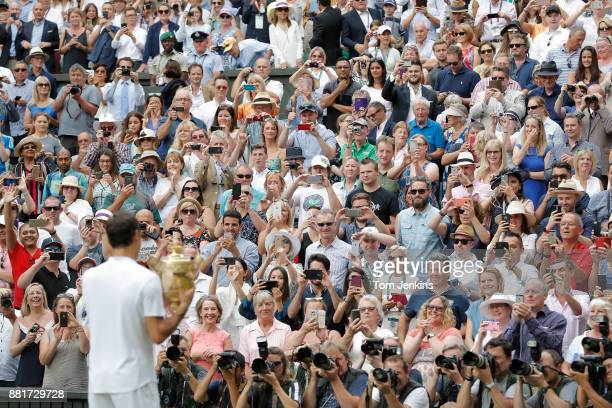 Roger Federer poses with the trophy after winning the men's singles final against Marin Cilic on Centre Court on day thirteen of the 2017 Wimbledon...