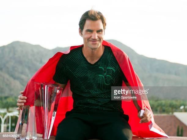 Roger Federer poses with trophy after winning the men's singles final at the BNP Paribas Open on March 19 at the Indian Wells Tennis Garden Indian...