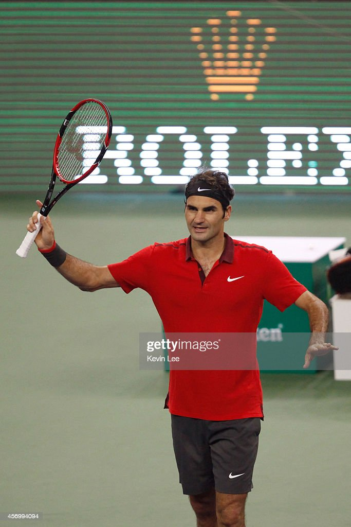 Roger Federer reacts after the Men's Singles Quarterfinal match Julien Benneteau of France during day 6 of the Shanghai Rolex Masters at Zi Zhong stadium on October 10, 2014 in Shanghai, China.