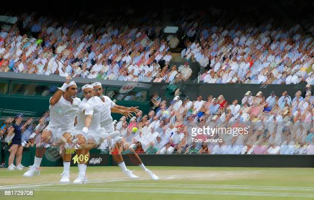 Roger Federer seen in a multiexposure during victory in the men's singles final v Marin Cilic on Centre Court on day thirteen of the 2017 Wimbledon...