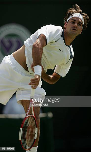 Roger Federer serves against Ivo Minar of Czech Republic during the third day of the Wimbledon Lawn Tennis Championship on June 22 2005 at the All...