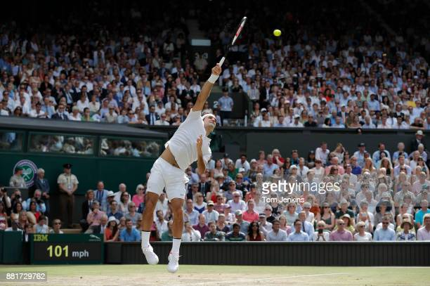 Roger Federer serves in the final game of the match before he sealed victory in the men's singles final v Marin Cilic on Centre Court on day thirteen...