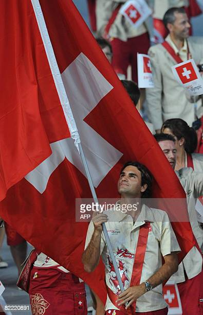 Roger Federer Switzerland's flag bearer parades in front of his delegation during the 2008 Beijing Olympic Games opening ceremony on August 8 2008 at...