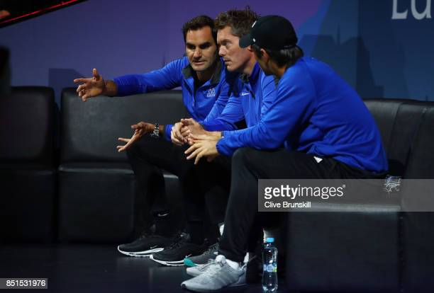 Roger Federer Thomas Enqvist and Fernando Verdasco of Team Europe look on as Dominic Thiem of Team Europe plays his singles match against John Isner...