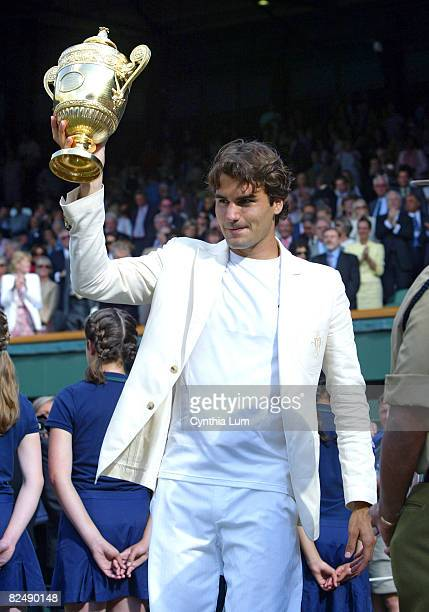 Roger Federer waves to the Centre Court fans after defeating Rafael Nadal in the Gentlemen's final of the 2006 Wimbledon Championship London July 9...