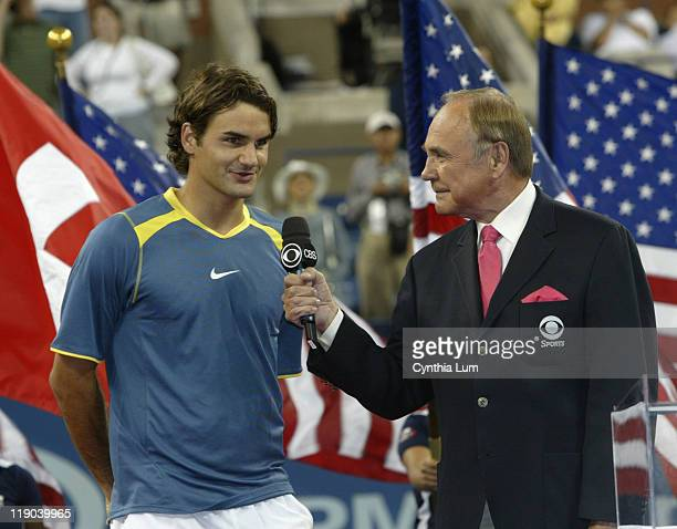 Roger Federer with Dick Enberg claims US Open Title defeating Andre Agassi in the final 63 26 76 9 61 at Arthur Ashe Stadium in Flushing New York on...