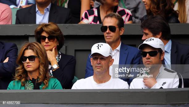 Roger Federer's wife Mirka and his team look on during his Gentlemen's Singles semi final match against Tomas Berdych on day eleven of the Wimbledon...