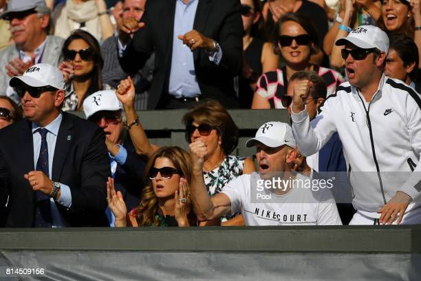 Roger Federer's wife Mirka and his team react during his Gentlemen's Singles semi final match against Tomas Berdych of The Czech Republic on day...