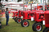 Roger Gibson pauses for the National Anthem while viewing the vintage tractor exhibit at the Iowa State Fair on August 7 2014 in Des Moines Iowa The...