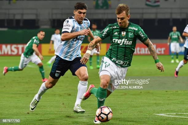 Roger Guedes of Brazil's Palmeiras vies for the ball with Fernando Evangelista of Argentina's Atletico Tucuman during their 2017 Copa Libertadores...