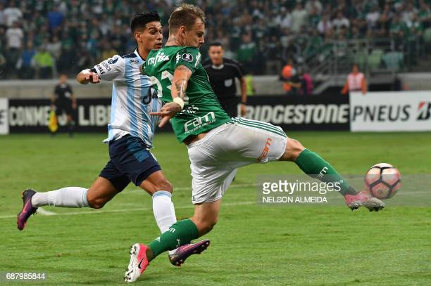 Roger Guedes of Brazil's Palmeiras vies for the ball with Javier Mendoza of Argentina's Atletico Tucuman during their 2017 Copa Libertadores football...