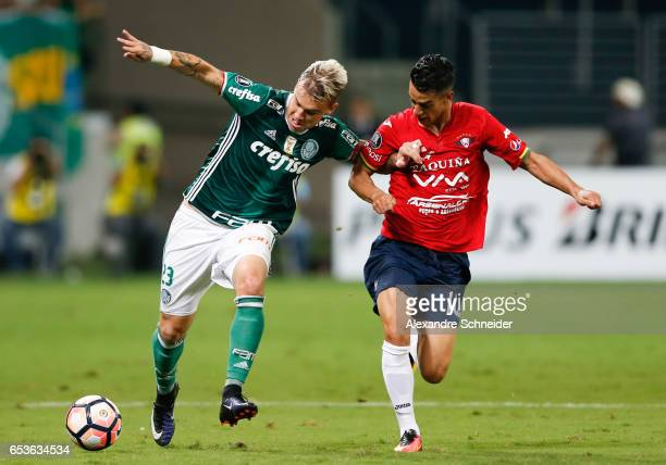 Roger Guedes of Palmeiras and Thomas of Jorge Wiltersmann in action during the match between Palmeiras of Brazil and Jorge Wiltersmann of Bolivia for...