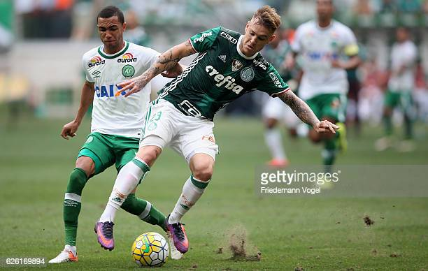 Roger Guedes of Palmeiras fights for the ball with Matheus Biteco of Chapecoense during the match between Palmeiras and Chapecoense for the Brazilian...