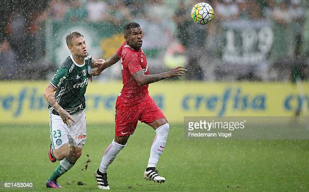 Roger Guedes of Palmeiras fights for the ball with Paulao of Internacional during the match between Palmeiras and Internacional for the Brazilian...
