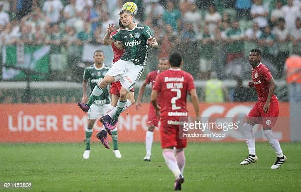 Roger Guedes of Palmeiras fights for the ball with Rodrigo Dourado of Internacional during the match between Palmeiras and Internacional for the...