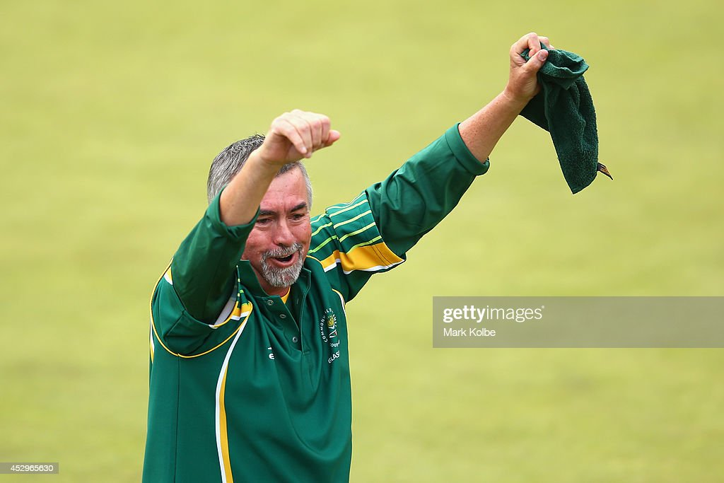 Roger Hagerty of South Africa celebrates their gold medal victory in the Para-Sport Open Triples B6/B7/B8 lawn bowls at Kelvingrove Lawn Bowls Centre during day eight of the Glasgow 2014 Commonwealth Games on July 31, 2014 in Glasgow, United Kingdom.
