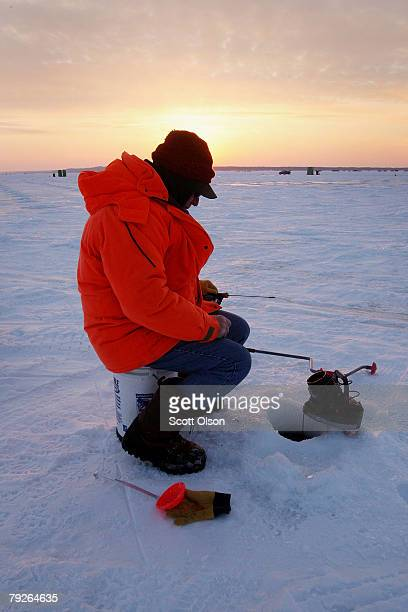 Roger Handeland test fishes an area of Gull Lake ahead of the Brainerd Jaycees Ice Fishing Extravaganza fishing tournament January 25 2008 in...