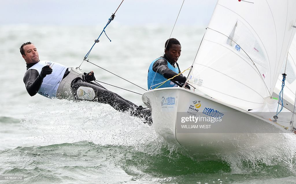 Roger Hudson and Asenathi Jim of South Africa sail through the waves in the 470 Men's class at the ISAF Sailing World Cup event in Melbourne on December 5, 2012. AFP PHOTO/William WEST IMAGE