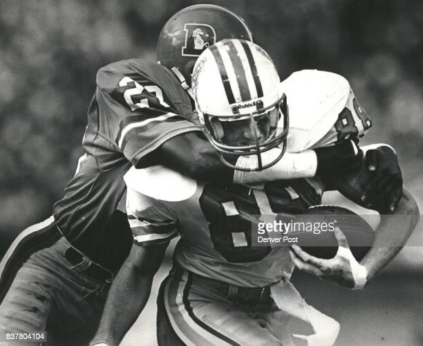 Roger Jackson gives Oilers Chris Dressel a bear hug tackle in the second half Credit The Denver Post